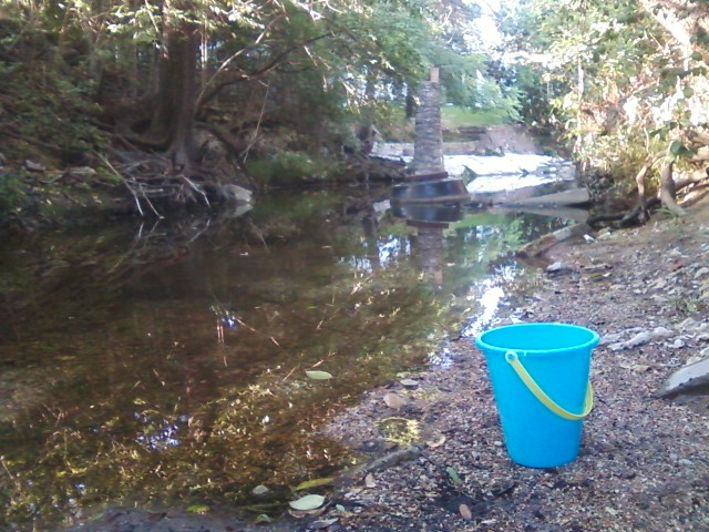 Waller Creek and child's bucket